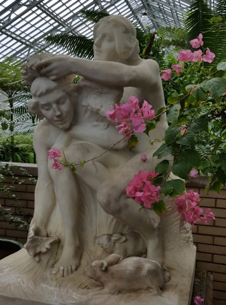 """This sculpture is called """"Pastoral."""" Lorado Taft originally sculpted it for a 1909 art exhibition. It was moved to the Conservatory's Palm House in 1913."""