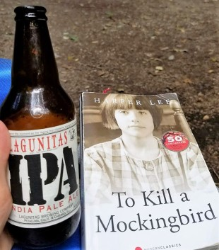 No camping trip is complete without a beer and book in hand.